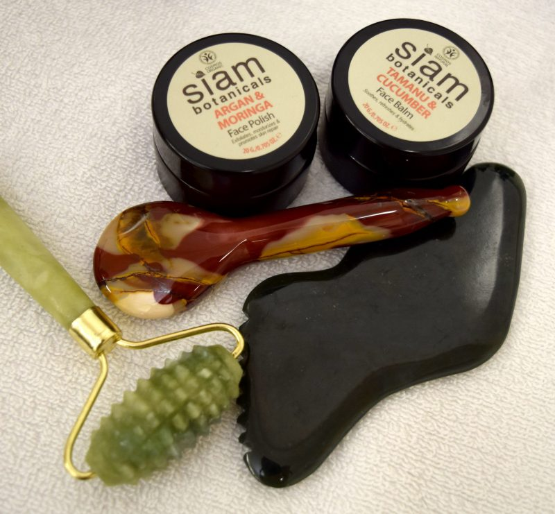Gua Sha stones and Siam skincare products